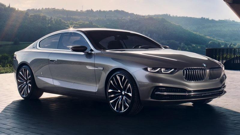 BMW serie 8 coupé, el modelo parado con una montaña al fondo.